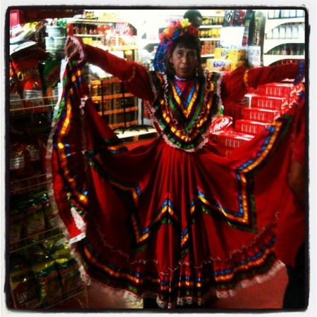 Traditional Red Mexican Dress. Full of color and life for Mexican Independence Day
