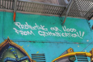 """Reads: """"Protecting our hood from gentrification"""""""