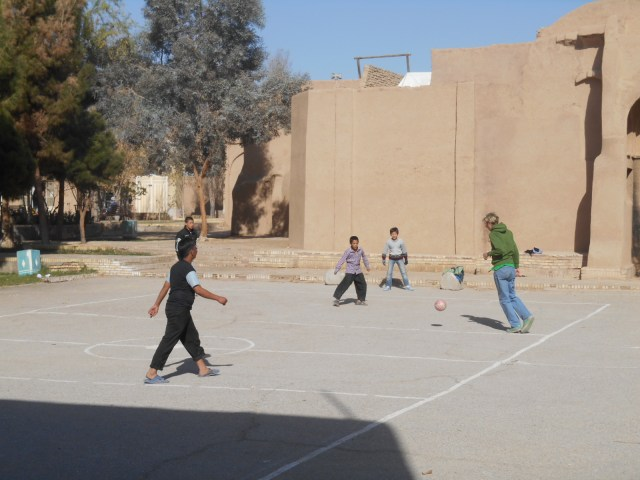 Playing football in the villages