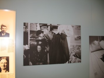 A photo of a practice drill in Corrie ten Boom's hiding place displayed in Auschwitz I museum.