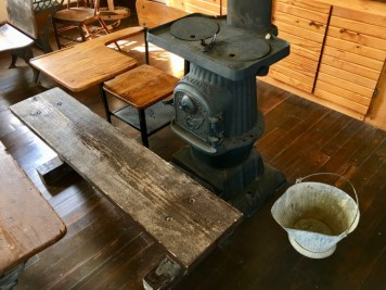 pot belly stove and vintage school desk