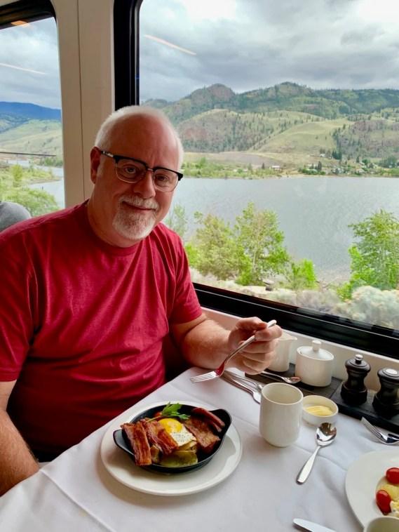 Howard Blount eating breakfast on the Rocky Mountaineer Train