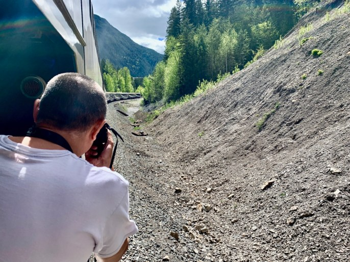 Man taking pictures on the Rocky Mountaineer Train