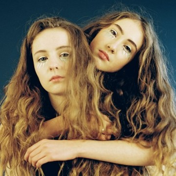 Let's Eat Grandma promotional photo of both female band members hugging