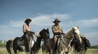 Travis and Gutjuk on horseback
