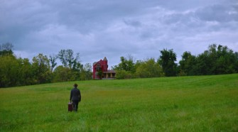 James approaches the remote farmhouse