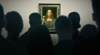 People looking at the Salvator Mundi the Louvre