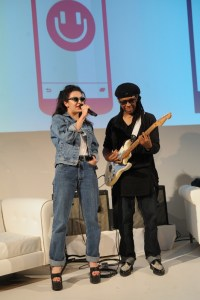 NEW YORK, NY - MAY 19:  Singer-songwriter Charli XCX and musician Nile Rodgers perform on stage at the MixRadio iOS and Android launch event at 404 on May 19, 2015 in New York City.  (Photo by Brad Barket/Getty Images for MixRadio) (PRNewsFoto/MixRadio)
