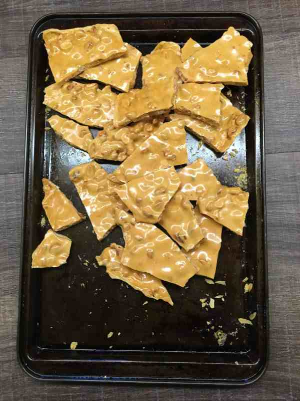 Easy Old Fashioned Peanut Brittle is a great holiday Christmas treat to make for friends, family, neighbors, and teachers. It's a cinch to make, and is just about the cheapest treat around.