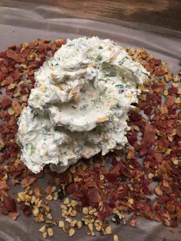 Easy Holiday Bacon Ranch and Walnut Cheeseball is a classic holiday appetizer. The cheeseball is the perfect food to bring to any party. I use pre made real bacon to make it quick and get it ready to eat.