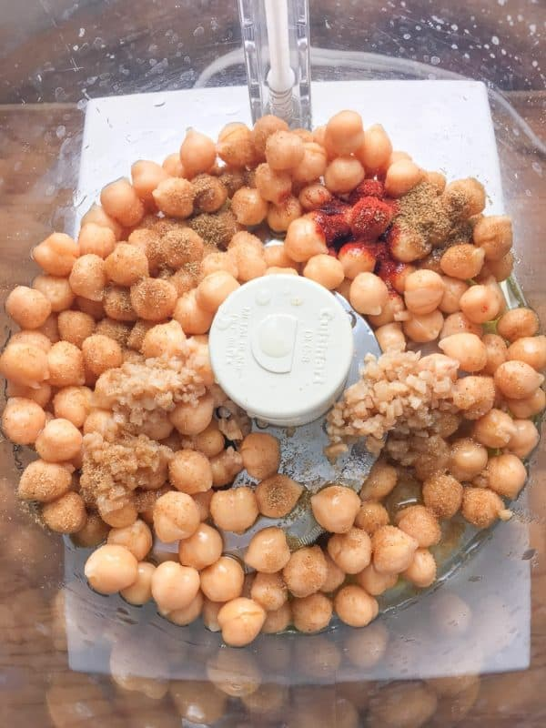 If you're wondering how to make hummus, this is an easy recipe that includes garlic, cumin, paprika, and chickpeas.