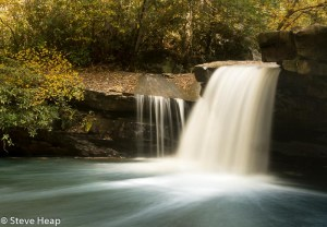 Cascade of waterfall into swimming hole with blurred motion on Deckers Creek running by Route 7 near Masontown in Preston County West Virginia