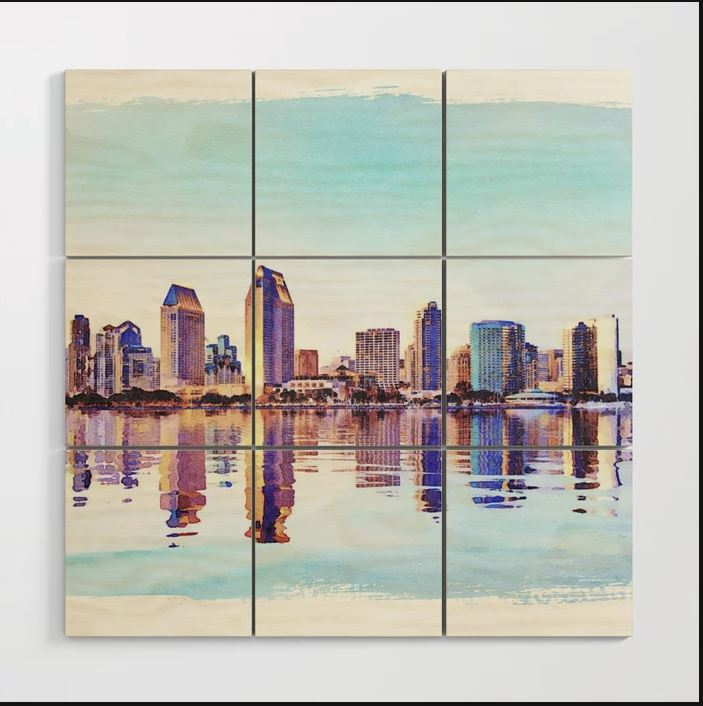 Wood block print of a digital watercolor painting of the skyline of San Diego