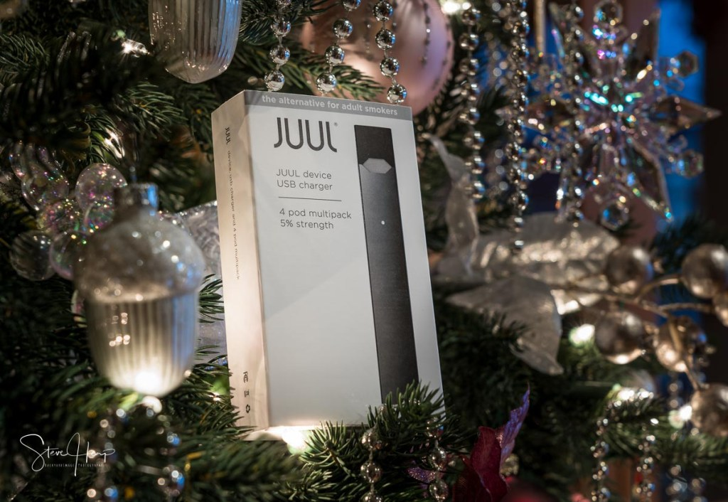 Illustrative Editorial image of Juul vaping system in a christmas tree as a present or gift for xmas