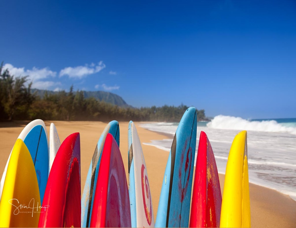Stock photo of surfboards lined up on Lumahai beach in Kauai