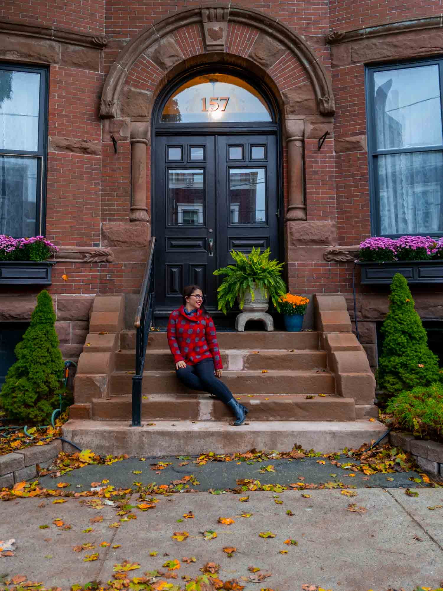 Ayngelina sitting on house stoop in Saint John New Brunswick