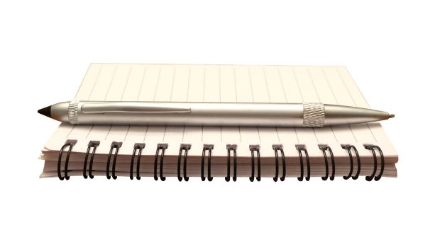48146741 - notepad and pen isolated for writing a note, journal or making a list