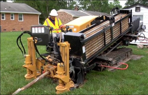 A screen capture from a Dominion video shows the machinery used to bury electric lines.