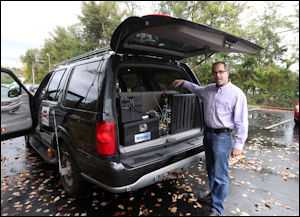 Don Perrone epitomizes the transportation revolution. Project manager at Crozet-based Perrone Robotics, he displays the innards of his self-driving car.