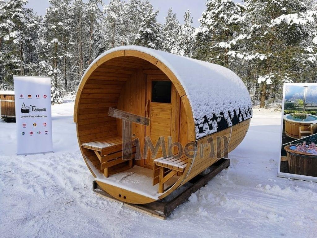 Fasssauna-Winter-mit-Veranda-und-Elektroofen-Harvia- Projekte
