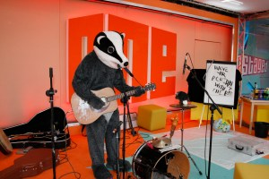 badger playing guitar