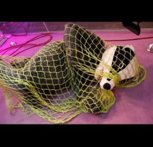 man in badger suit in net