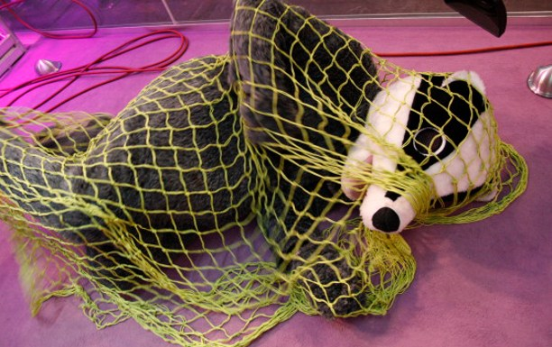 man in badger suit in net