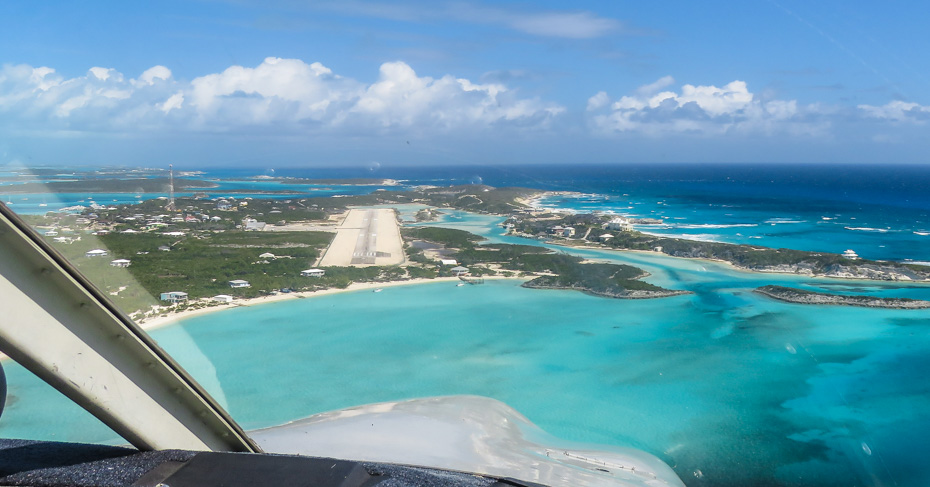 Flying into Staniel Cay Airport in the Exuma Cays. From Staniel Cay you can visit the Exuma Pigs, swimming pigs, iguanas, Thunderball Grotto from James Bond film Thunderball. Bahamas day trips and Island hopping tours.