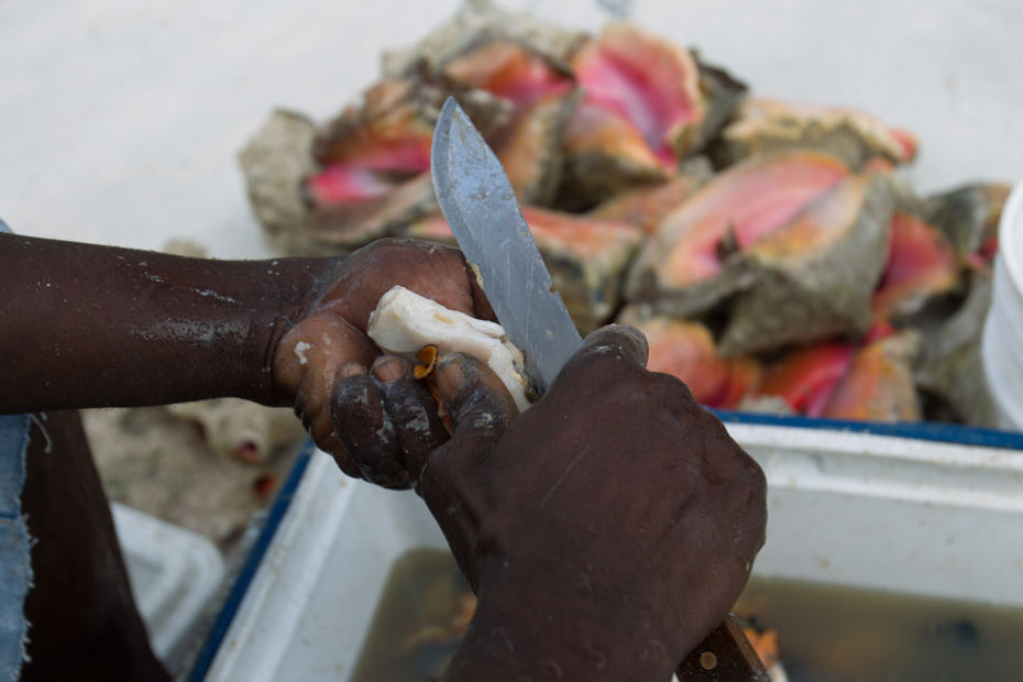 Conch Food Cooking and preperation of conch shells in the Bahamas for a traditional Conch Salad