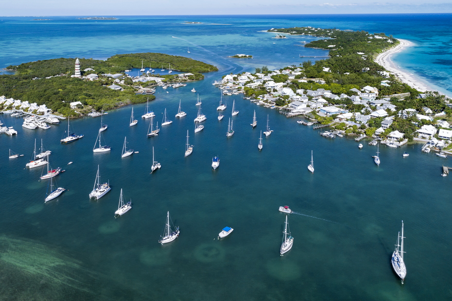 Treasure Cay Flights give amazing views of the harbour and lighthouse in Hope Town on Elbow Cay off the island of Abaco, Bahamas.