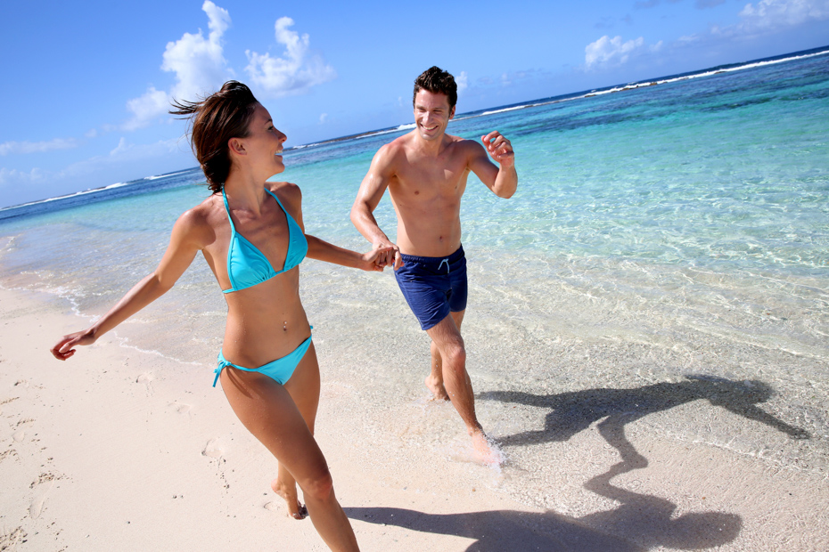 Couple running on a sandy beach. Bahamas cruise from Miami to Bahamas from Bahamas Air Tours Day trip to Bahamas is one of the best one day trip from Miami to Bahamas. A Day Cruise Miami is the perfect one day trip to Bahamas. A Perfect Bahamas Cruise Miami for any young couple.