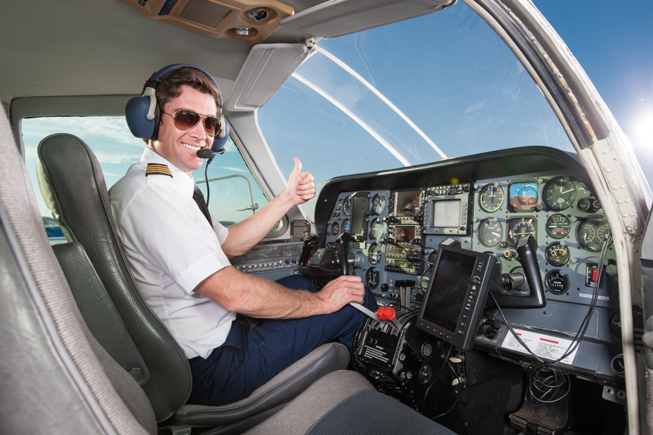 A smiling pilot in the cockpit of a small commuter airplane is giving the thumbs-up sign with his left hand. His right hand is on the control stick, and he is wearing his headset and sunglasses. The co-pilot's chair on his right is empty. Check out this Miami to Bahamas flight on a Bahamas charter you've always dreamed of. Imagine yourself on one of our flights from Miami to Nassau or other flights to Bahamas ready to enter paradise. Our Florida to Bahamas flights are one of the best day trips in Florida. Bahamas Air Tours gives you your guide to Day Trips to Bahamas by flights to Bahamas aboard Bahamas Air Charters to Swimming Pigs tours and the Exuma pigs on Pig Island at Pig Beach. Join one of our Staniel Cay Day trips on our Nassau to Staniel Cay day tour or opt for the Staniel Cay Day trips by the way of Bahamas Day Trips by plane. Trips to Bahamas to see pigs in Bahamas. Miami to Bahamas day trip is one of the top Florida attractions.