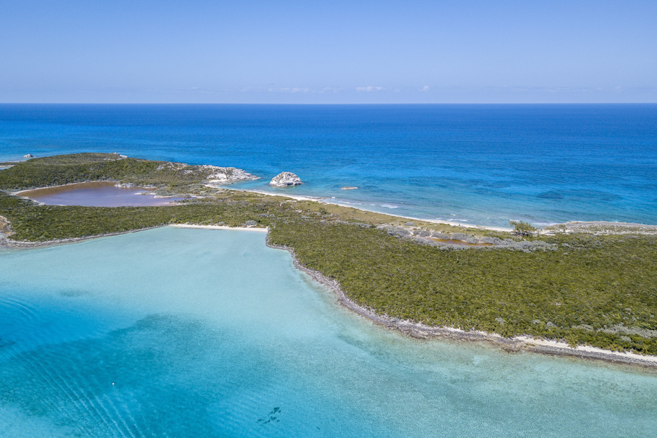 Aerial view of the beautiful Bahamas. Exuma Pig Beach on Big Major Cay isn't far from Staniel Cay. Climb aboard a Nassau to Staniel Cay day tour or opt for the Staniel Cay Day trip by the way of Bahamas Day Trip by plane.