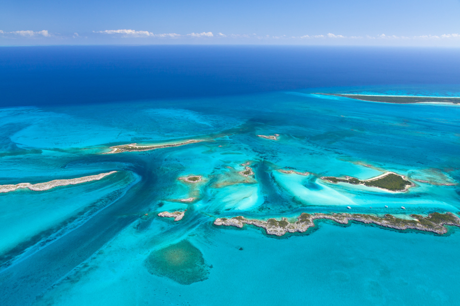 Gorgeous aerial shot of Exuma Cays. Swim with pigs Nassau day trip to Bahamas. Day trips from Nassau to Exuma pigs.