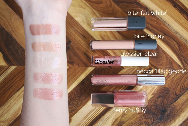 lip glosses lined up and swatched on arm