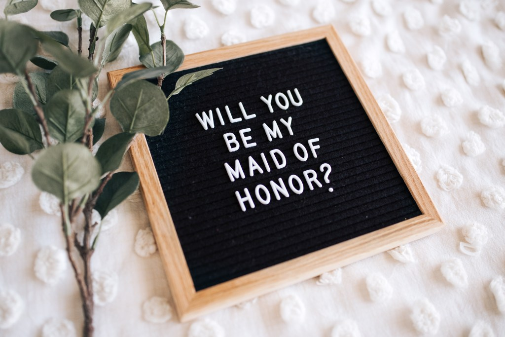 """will you be my maid of honor?"" written out on a letterboard"
