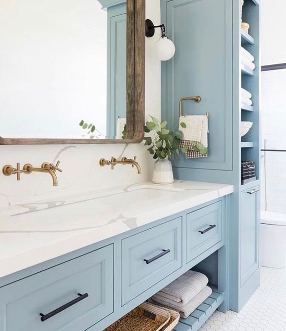 light blue bathroom vanity with marble countertop