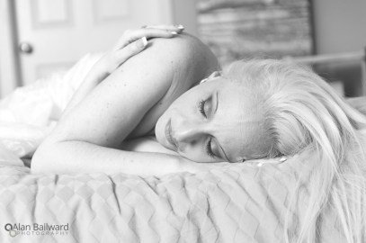 Implied nude in black and white with eyes closed