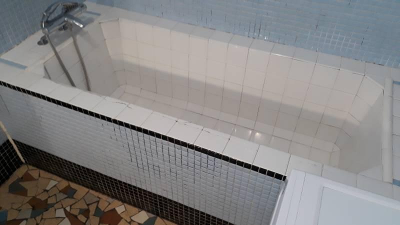 installation de baignoire avec porte