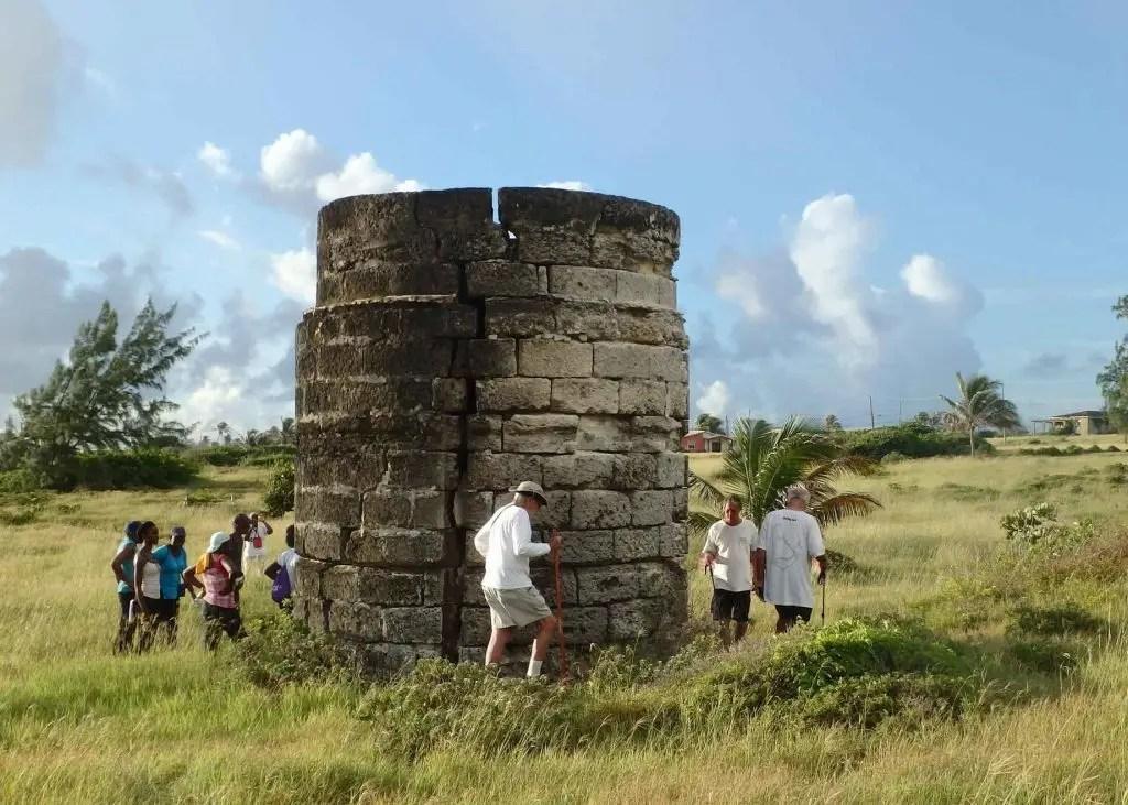 Saturday Hikers examining abandoned Lime Kiln.