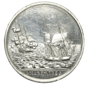 Medal struck to commemorate the loss of the East Indiaman Kent - 1st March 1825. Obverse: Starboard broadside view of the brig 'Cambria' (right) hove-to and starboard-quarter view of the three-masted East Indiaman 'Kent' on fire (left), two boats plying between the two vessels. Exergue: '1 MARCH, 1825'. Reverse: Legend, 'FROM FALMOUTH, TRURO, HELSTON, PENRYN AND ST IVES'. Inscription: 'TO COMMEMORATE THE DESTRUCTION OF THE KENT EAST INDIAMAN BY FIRE, IN THE BAY OF BISCAY; AND THE RECEPTION ON BOARD THE BRIG CAMBRIA, WILLIAM COOK, MASTER, OF 547 PERSONS, THUS PROVIDENTIALLY DELIVERED FROM DEATH.' Inscription (on edge): 'IOHN MACKENNY'. 50 or 60 of these medals were struck in silver for issue to specific individuals and an unknown number in copper and white metal were sold as souvenirs.