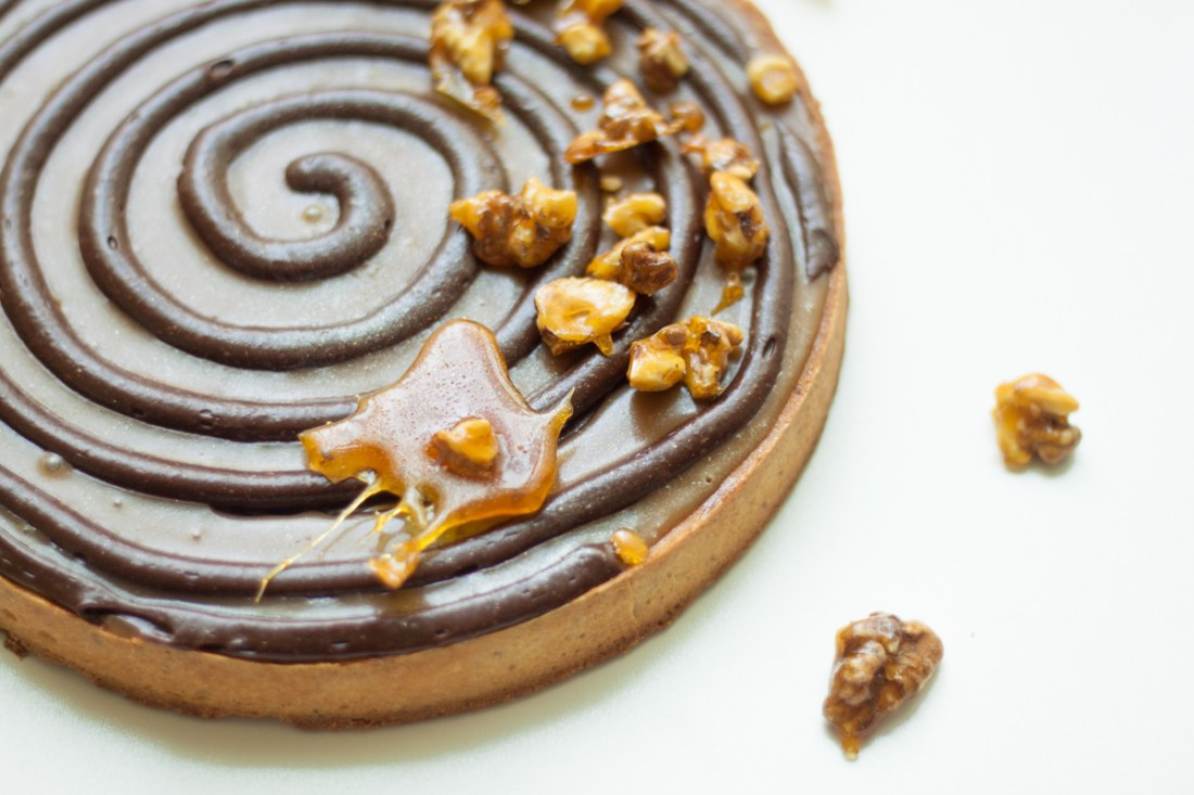 Chocolate and caramel swirl tart with caramelized walnuts