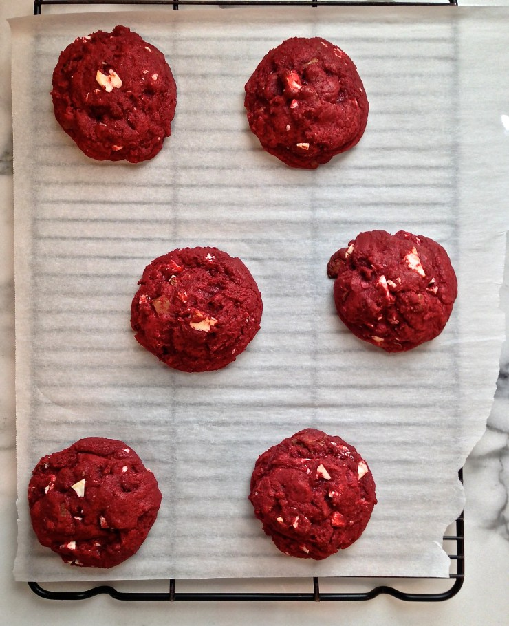 red velvet double chip cookies cooling on wire rack