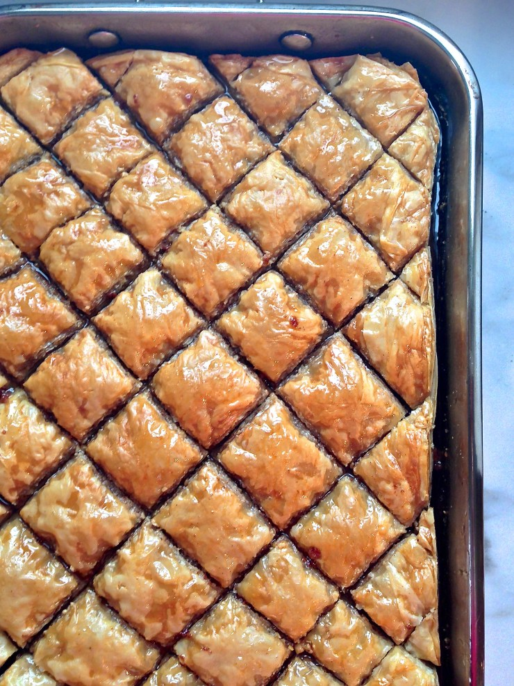 baklava cut and soaking in honey syrup