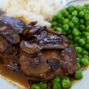 This Slow Cooker Salisbury Steak (with mushrooms and gravy) is so good it tastes just like the classic dish!