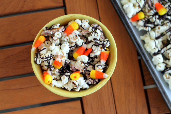 This White Chocolate Candy Corn Popcorn is tossed with with pretzels, candy corn, white chocolate, and a drizzle of dark chocolate for a Halloween treat!