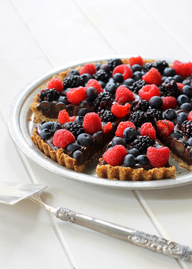 This Chocolate Berry Tart has vegan chocolate ganache in an almond flour crust, topped with berries! It is Paleo, gluten-free, vegan and refined sugar-free.