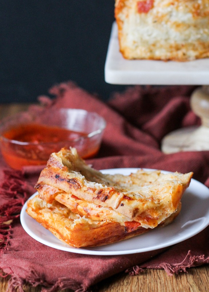 This Pepperoni Pizza Pull Apart Bread features soft layers of homemade bread loaded with tomato sauce, cheese, and pepperoni for an appetizer that's sure to be a fan favorite.
