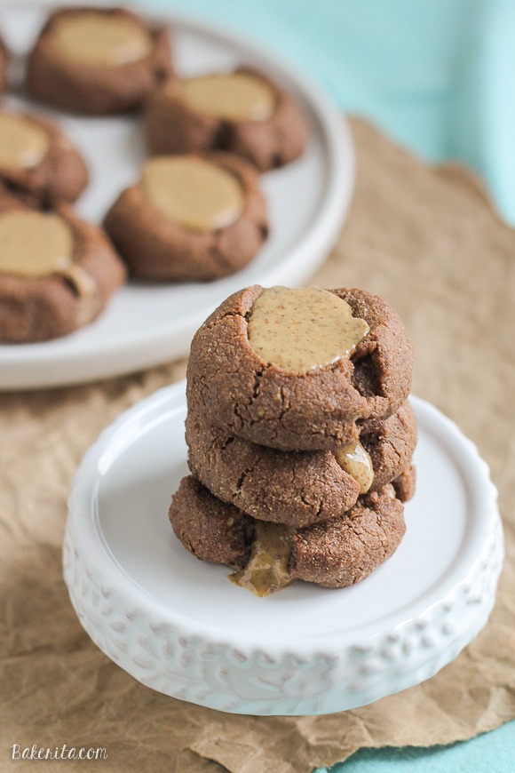 You're only six ingredients away from these delicious Paleo Chocolate Almond Butter Thumbprint Cookies! This easy cookie recipe is also refined sugar free and vegan.
