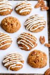 These Carrot Cake Cookies are drizzled with cream cheese glaze and taste just like carrot cake! The cookies are gluten-free, grain-free, and refined sugar-free.